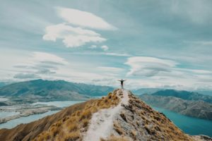 person on mountain top path
